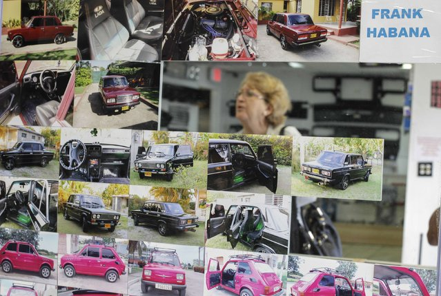 A woman is reflected in a mirror covered in photographs of different models of the Lada car in Fabian Zakharov's Zakharov Auto Parts shop in Hialeah, Florida, February 4, 2015. (Photo by Javier Galeano/Reuters)