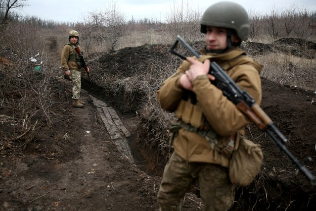 Ukrainian servicemen patrol along a position at the front line with Russia-backed separatists not far Avdiivka, Donetsk region on April 5, 2021. (Photo by AFP Photo/Stringer)