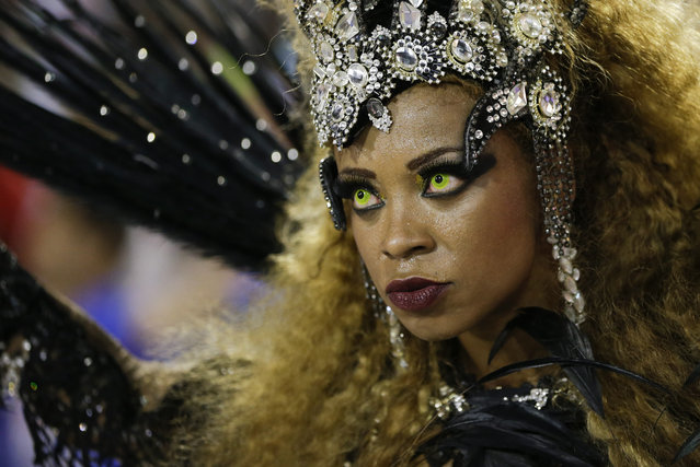 A performer from the Uniao da Ilha do Governador samba school parades during carnival celebrations at the Sambadrome in Rio de Janeiro, Brazil, Tuesday, February 17, 2015. (Photo by Felipe Dana/AP Photo)