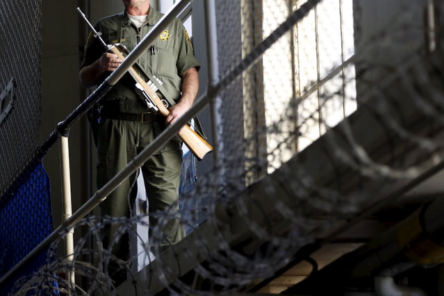 An armed guard patrols on the East Block for condemned prisoners during a media tour of California's Death Row at San Quentin State Prison in San Quentin, California December 29, 2015. (Photo by Stephen Lam/Reuters)