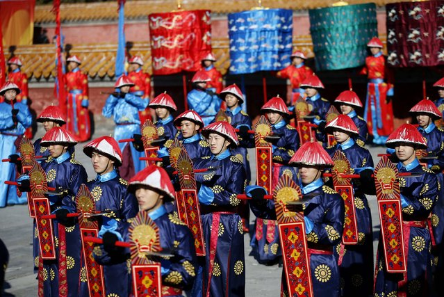 Performers, dressed as Qing dynasty warriors, take part in the re-enactment of the ancient Qing Dynasty ceremony, in which emperors prayed for good harvest and fortune, during the opening of the Temple Fair, which is part of Chinese New Year celebrations at Ditan Park, also known as the Temple of Earth, in Beijing, February 18, 2015. (Photo by Kim Kyung-Hoon/Reuters)