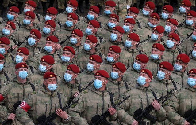 Servicemen march in formation during a rehearsal for a Victory Day military parade in Red Square marking the 76th anniversary of the victory over Nazi Germany in World War II, at the Alabino training ground in Moscow Region, Russia on April 16, 2021. (Photo by Alexander Shcherbak/TASS)