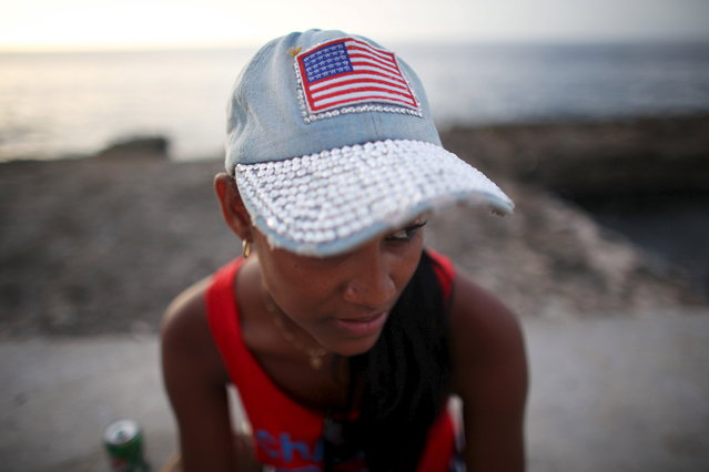 Hotel worker Yaneici Rodriguez, 22, sits at the seafront Malecon in Havana, July 18, 2015. (Photo by Alexandre Meneghini/Reuters)