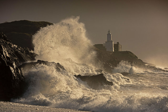 Huge waves smash into the rocks in front of the Mumbles Lighthouse at Bracelet Bay in Swansea, Wales on November 2, 2020. (Photo by Phil Rees/Rex Features/Shutterstock)