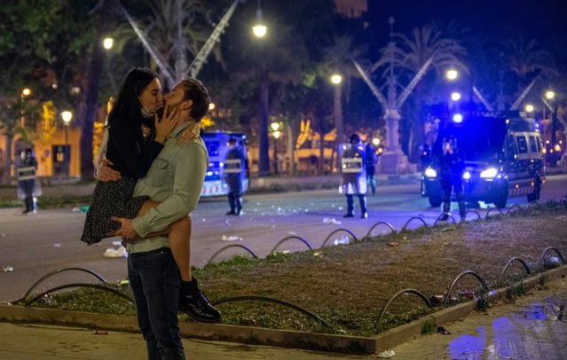 A couple kisses in a central Barcelona street during the first night without the state of alarm, on 9 May, 2021 in Barcelona, Catalonia, Spain. The state of alarm that the Government decreed for the second time six months ago ended at 00.00 hours this Sunday, May 9. In Catalonia this has led to the fall of the curfew and the perimeter confinement of the Community. (Photo By Lorena Sopena via Getty Images)