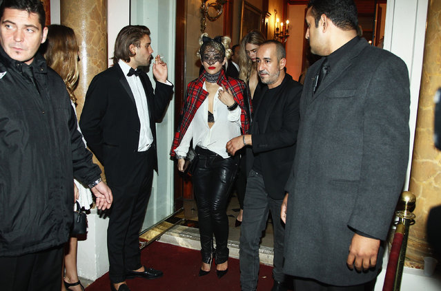 """Rita Ora and Cara Delevingne leave the """"Mademoiselle C"""" cocktail party at Pavillon Ledoyen on October 1, 2013 in Paris, France. (Photo by Julien M. Hekimian/Getty Images)"""