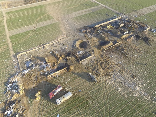 An aerial view shows the debris at an explosion site at a factory making fireworks among corn fields in Xutong County of Kaifeng, Henan province, China, January 14, 2016. At least 10 people were killed and seven others injured by an explosion at an illegal fireworks plant in Henan province on Thursday, Xinhua News Agency reported. (Photo by Reuters/Stringer)