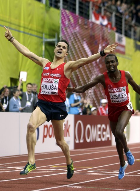 Jakub Holusa of the Czech Republic celebrates winning the men's 1500 metres final ahead second placed Tanui Ilham Ozbilen of Turkey (R) during the European Indoor Championships in Prague March 8, 2015. REUTERS/David W Cerny (CZECH REPUBLIC  - Tags: SPORT ATHLETICS)