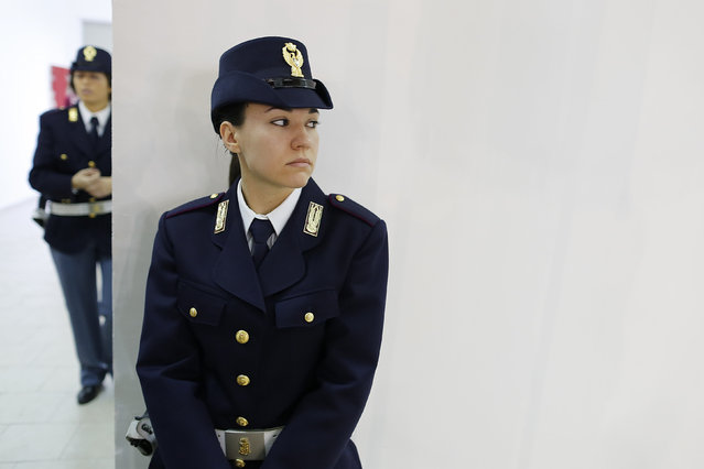 Italian Policewomen stand guard before the futsal match between Sporting Locri and Lazio in Locri, Italy January 10, 2016. (Photo by Tony Gentile/Reuters)