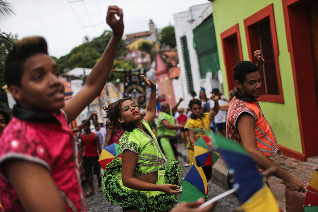 Revellers dance during pre-Carnival celebrations on January 30, 2016 in Recife, Pernambuco state, Brazil. Health officials believe as many as 100,000 people have been exposed to the Zika virus in Recife, although most never develop symptoms. Carnival celebrations are continuing normally as planned. In the last four months, authorities have recorded around 4,000 cases in Brazil in which the mosquito-borne Zika virus may have led to microcephaly in infants. (Photo by Mario Tama/Getty Images)