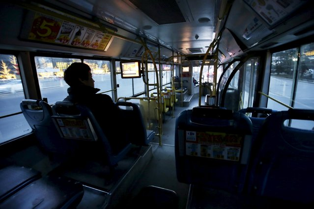 A passenger sits in an otherwise empty No. 43 bus travelling along Jianguomen Outer Street on the eve of the Chinese Lunar New Year, in Beijing, China, February 7, 2016. (Photo by Jason Lee/Reuters)