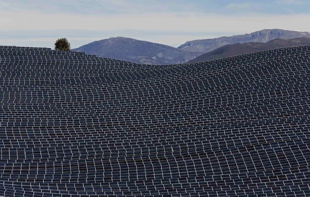 A general view shows solar panels to produce renewable energy at the photovoltaic park in Les Mees, in the department of Alpes-de-Haute-Provence, southern France March 31, 2015. (Photo by Jean-Paul Pelissier/Reuters)