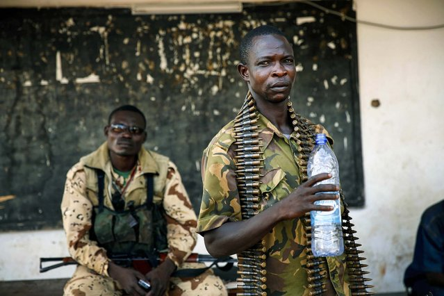 Seleka soldiers rest at their military camp in Bangui, Central African Republic following a day-long gun battle between Seleka soldiers and Christian militias, on December 5, 2013. (Photo by Jerome Delay/Associated Press)