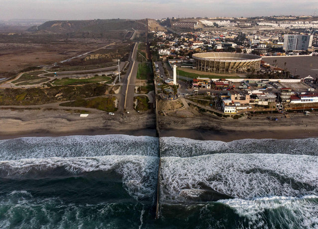 Aerial view of the US-Mexico border fence seen from Playas de Tijuana, Baja California state, on January 11, 2019. (Photo by Guillermo Arias/AFP Photo)