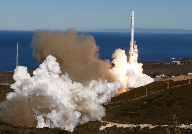 SpaceX Falcon rocket lifts off from Space Launch Complex 4E at Vandenberg Air Force Base, California, U.S., January 14, 2017. The two-stage rocket lifted off  to place 10 satellites into orbit for Iridium Communications Inc.  About nine minutes later, the first stage returned to Earth and landed successfully on a barge in the Pacific Ocean south of Vandenberg. (Photo by Gene Blevins/Reuters)