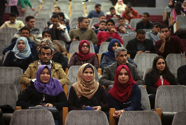 Palestinian spectators watch a movie at Red Crescent Society hall in Gaza City February 25, 2016. Palestinians in the Gaza Strip are enjoying their first night out at the movies since political tensions led to the torching of cinemas in the enclave 20 years ago. (Photo by Mohammed Salem/Reuters)
