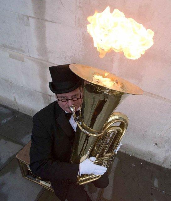 Fire Flaming Tuba Player, London. (Photo by ZUMA Press/REX)