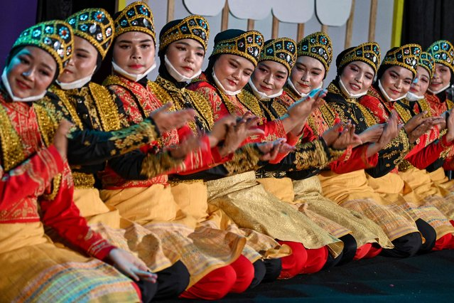 """Dancers perform a """"Ratoh Jaroe"""" festival for online viewers, an Aceh famous traditional dance, in Banda Aceh, Indonesia on September 8, 2021.(Photo by Chaideer Mahyuddin/AFP Photo via Getty Images)"""