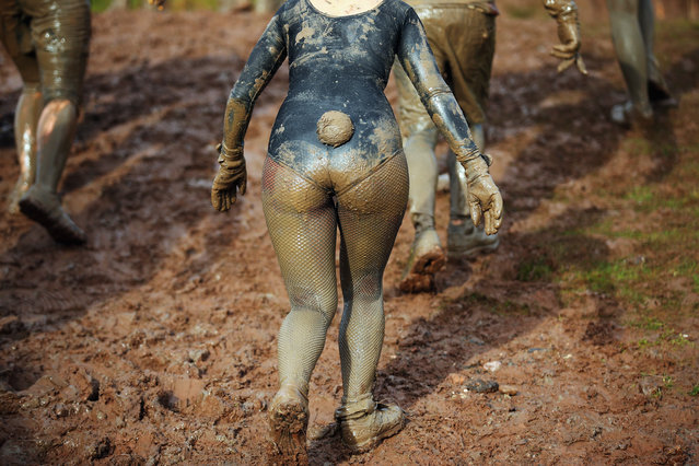 A competitor  climbs a mud banking during the Tough Guy Challenge on January 26, 2014 in Telford, England.  (Photo by Bryn Lennon/Getty Images)