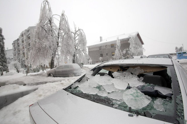 A car with a smashed rear windscreen is seen amid heavy ice in Postojna February 5, 2014. (Photo by Srdjan Zivulovic/Reuters)