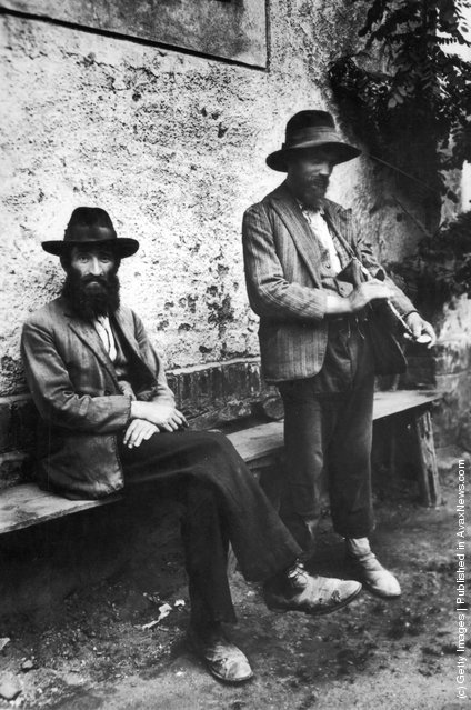circa 1925:  Two Russian Jewish refugees. One of the men is looking at his watch