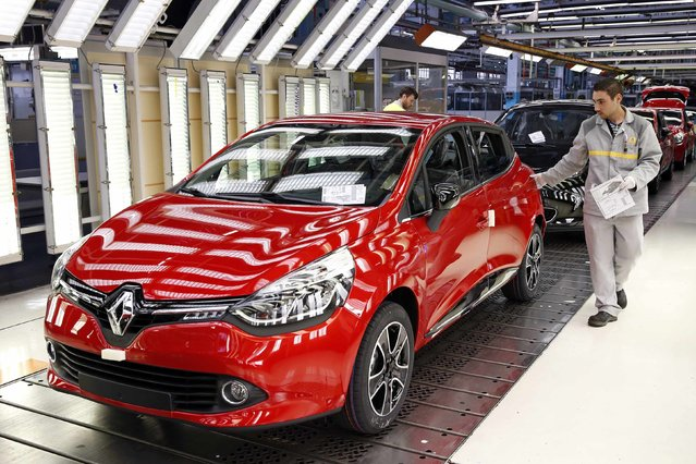 A Renault Clio IV car is pictured in the final check area at the Renault automobile factory in Flins, west of Paris, France, May 5, 2015. (Photo by Benoit Tessier/Reuters)