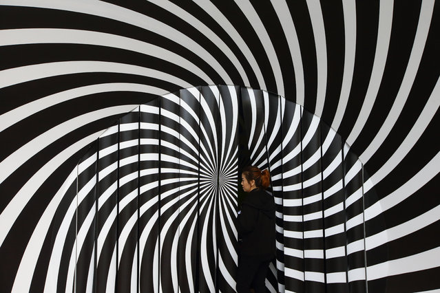"An usher stands at the entrance to the ""Wonderland"" exhibition at ArtScience Museum in Marina Bay Sands on April 15, 2019 in Singapore. Wonderland runs from 13 April to 22 Spetember 2019. (Photo by Suhaimi Abdullah/Getty Images)"