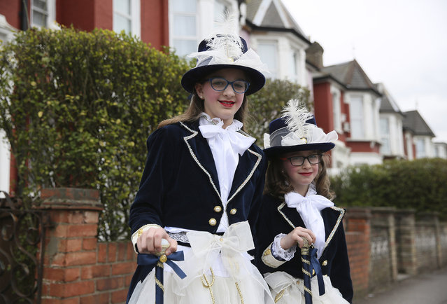 Children from the Jewish community dressed in costumes pose for a portrait during the festival of Purim in Stamford Hill in north London, Britain March 24, 2016. (Photo by Neil Hall/Reuters)