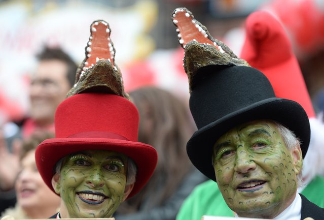 Costumed carnival goers walk during the traditional Rose Monday parade in Duesseldorf, western Germany on March 3, 2014. Carnival goers mainly in the Rhine region traditionally celebrate the highlight procession on Rosenmontag (Rose Monday). (Photo by Patrik Stollarz/AFP Photo)