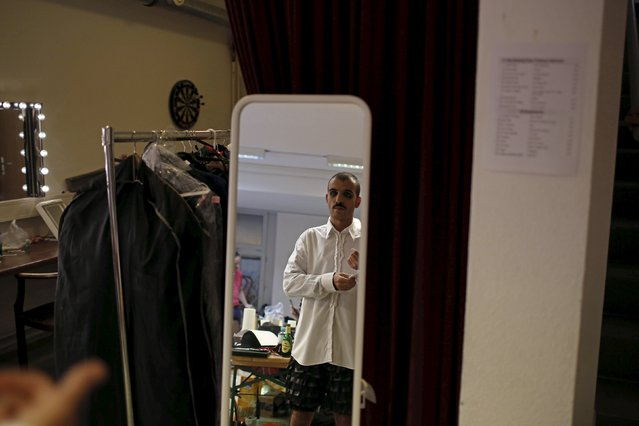 "Boylesque performer Gonzalo De Laverga from Italy prepares before the ""Yodeling Lederhosen Boylesque Gala"" at the Boylesque Festival in Vienna, Austria, May 15, 2015. Picture taken May 15, 2015. (Photo by Leonhard Foeger/Reuters)"