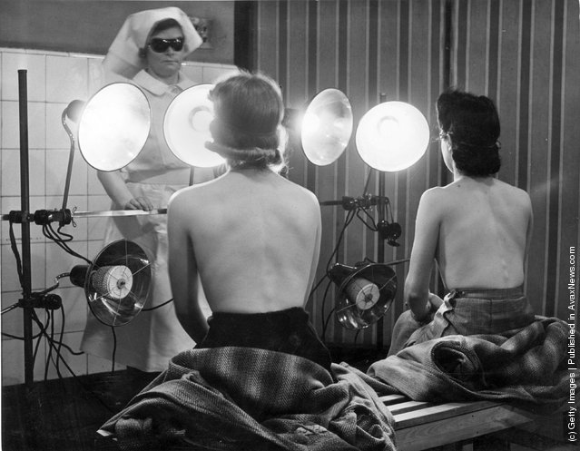 1942: Civil Defence Workers in Finsbury are beating the winter pallor with free sun lamp treatments