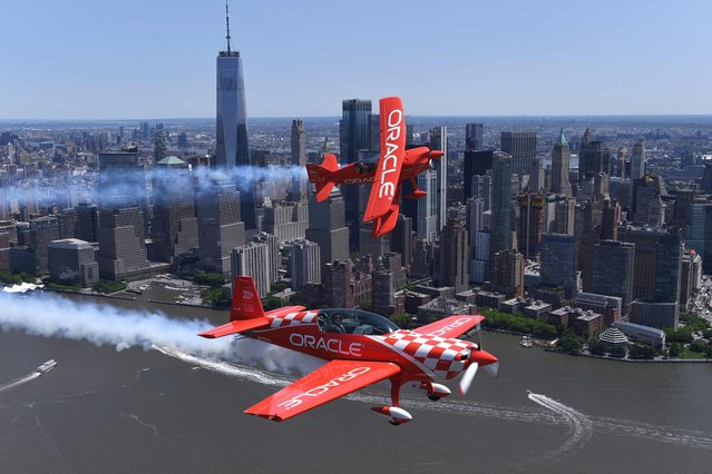 Aerobatic pilots Sean D. Tucker and Jessy Panzer (foreground) of Team Oracle fly down the Hudson River past the World Trade Center on May 22, 2019 during a media day in advance of the Bethpage Air Show at Jones Beach over Memorial Day weekend. Tucker will be performing at air shows this summer and fall alongside Jessy Panzer, the only civilian female formation airshow pilot in the United States. (Photo by Timothy A. Clary/AFP Photo)