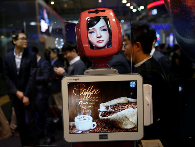 Commerce Bot, a robot that provides customer service with artificial intelligence technology and voice recognition is seen at SK telecom's stand at the Mobile World Congress in Barcelona, Spain, February 28, 2017. (Photo by Paul Hanna/Reuters)