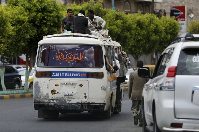 People ride atop a crowded bus in Yemen's capital Sanaa May 6, 2015. Acute fuel shortages have brought most of the public transportation means in Yemen to a standstill. (Photo by Khaled Abdullah/Reuters)