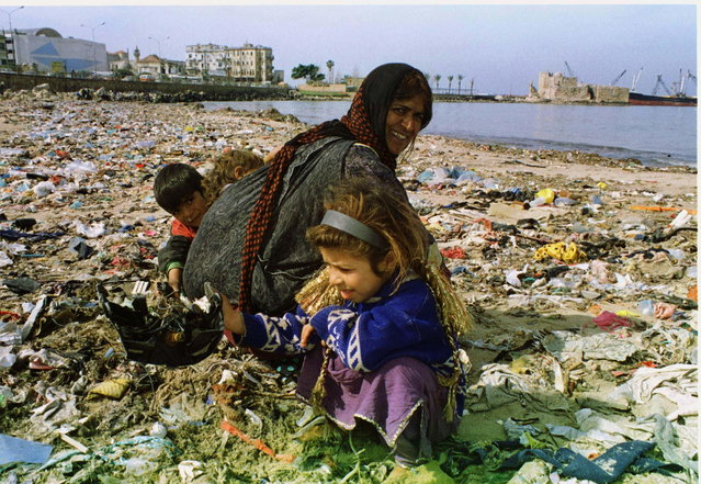 A Lebanese gypsy woman and her children search in the rubbish at the beach of the port city of Sidon, March 2. Tonnes of garbage were thrown across the sandy beach by high waves over the weekend. (Photo by Reuters/Stringer)