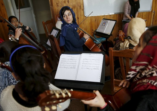 Fakria Azizi, a member of the Zohra orchestra, an ensemble of 35 women, practises during a session, at Afghanistan's National Institute of Music, in Kabul, Afghanistan April 4, 2016. (Photo by Ahmad Masood/Reuters)