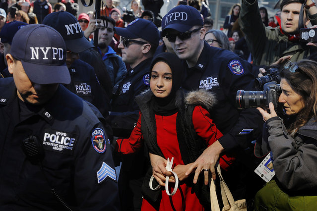 New York Police Department officers arrest a woman who was taking part in a 'Day Without a Woman' march on International Women's Day in New York, March 8, 2017. (Photo by Lucas Jackson/Reuters)