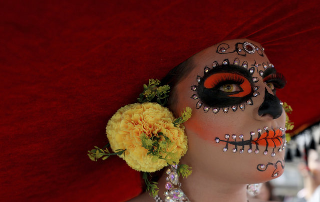 """A reveler dressed as a Mexican """"catrina"""" participates in the gay pride parade in Bogota, Colombia, Sunday, June 30, 2019. Thousands paraded during the annual gay pride parade in support of peace and against sexual discrimination. (Photo by Fernando Vergara/AP Photo)"""