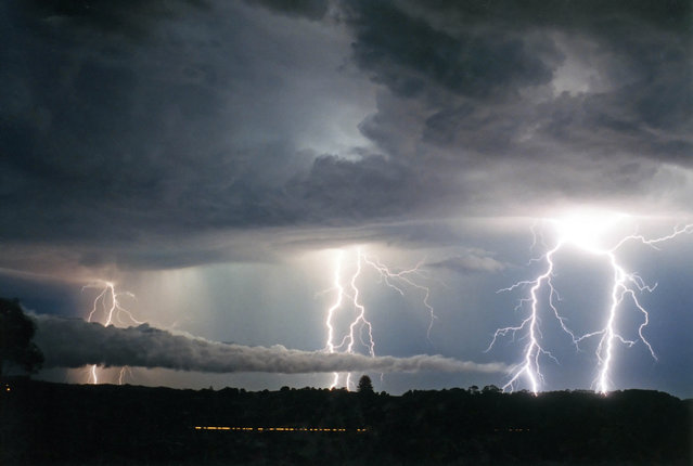 """Lightning Flash Photography"". Alstonville, New South Wales, Australia – January 8, 2003. (Photo by Michael Bath/Caters News)"