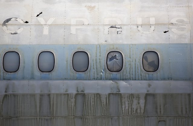 A Cyprus Airways passenger jet stands in the abandoned Nicosia International Airport near Nicosia March 10, 2014. (Photo by Neil Hall/Reuters)