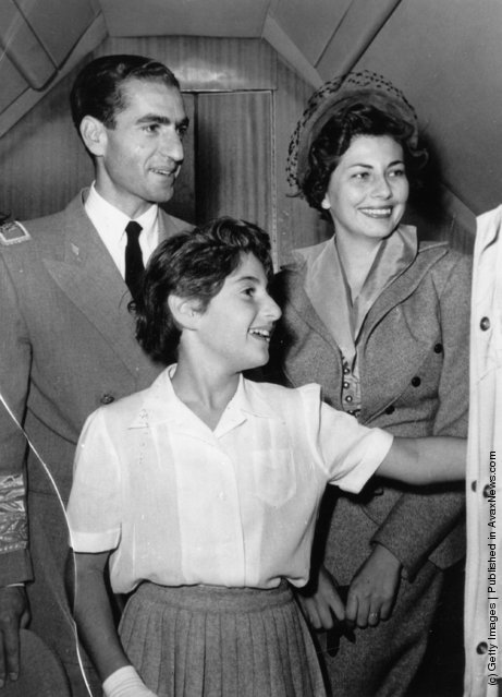 1953:  Mohammed Reza Pahlavi, Shah of Iran, with his wife Soraya, Queen of Persia and daughter Princess Shahnaz at the airport at Tehran, bound for Switzerland.  The Shah left Persia for an indefinite period during which a Regency Council governed the country