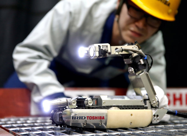 A robot jointly developed by Toshiba and the International Research Institute for Nuclear Decommissioning (IRID) is demonstrated at Toshiba's Keihin Product Operations on June 30, 2015 in Yokohama, Kanagawa, Japan. The robot is scheduled to be brought in to the No.2 reactor of the crippled Fukushima Daiichi Nuclear Power Plant in August. (Photo by The Asahi Shimbun via Getty Images)