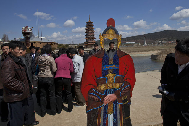 North Koreans visit the Pyongyang Folk Park on the outskirts of Pyongyang Thursday, April 11, 2013. The park, which spans Korean history from prehistoric to modern times, opened in September 2012 after three years of construction by North Korean soldiers. (Photo by David Guttenfelder/AP Photo)