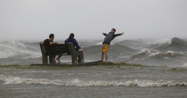 People play in the storm surge from Hurricane Isaac, on Lakeshore Drive along Lake Pontchartrain, as the storm nears land, in New Orleans, Tuesday, August 28, 2012. (Photo by Gerald Herbert/AP Photo)