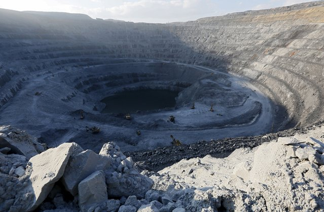 A general view shows the 550-metre-deep Vostochny opencast of the Olimpiada gold operation, owned by Polyus Gold International company, in Krasnoyarsk region, Eastern Siberia, Russia, June 30, 2015. Polyus Gold International is the largest gold producer in Russia and one of the top 10 gold miners globally by ounces produced, according to the official web site of the company. Olimpiada is Polyus Gold's largest operation. (Photo by Ilya Naymushin/Reuters)