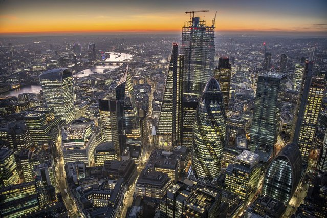 The city of London at dusk. (Photo by Jason Hawkes/Caters News Agency)