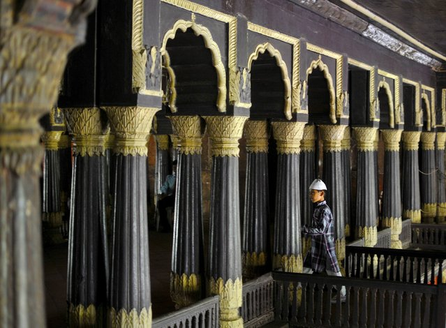 A Muslim boy walks through the corridor of Tipu Sultan's Summer Palace before offering Friday prayers in a nearby mosque in Bengaluru, India, July 10, 2015. (Photo by Abhishek N. Chinnappa/Reuters)