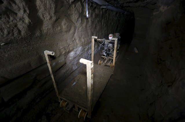 "A rail cart attached to a modified motorcycle is seen inside a tunnel connected to the Altiplano Federal Penitentiary and used by drug lord Joaquin ""El Chapo"" Guzman to escape, in Almoloya de Juarez, on the outskirts of Mexico City, July 15, 2015. (Photo by Edgard Garrido/Reuters)"