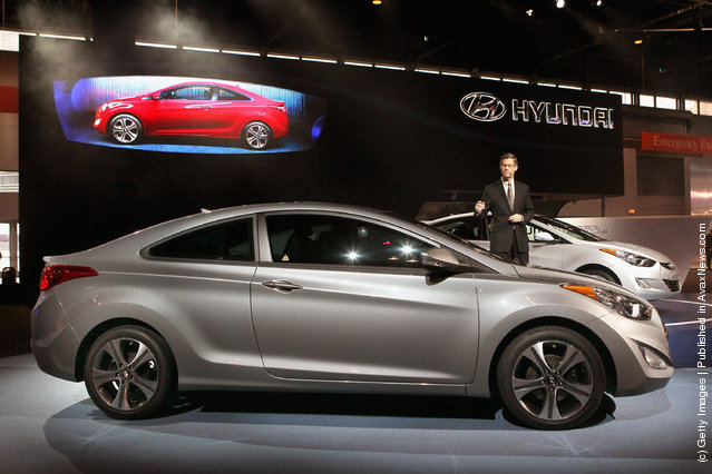 Mike O'Brien, vice president of product and corporate planning at Hyundai, introduces the 2013 Hyundai Elantra Coupe during the media preview of the Chicago Auto Show