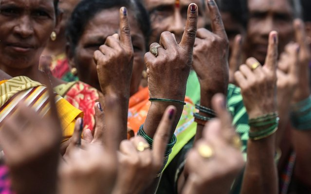 Indian voters show their ink marked fingers after voting at a polling station during the Maharashtra state election, in Mumbai, India, 21 October 2019. The result will be announced on 24 October. (Photo by Divyakant Solanki/EPA/EFE/Rex Features/Shutterstock)